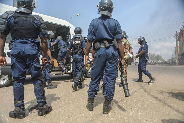 Police officers are seen in Cotonou, Benin, on March 9, 2018. Beninese authorities recently launched a fake news investigation into Casimir Kpedjo, editor of the privately owned daily Nouvelle Economie. (AFP/Yanick Folly)