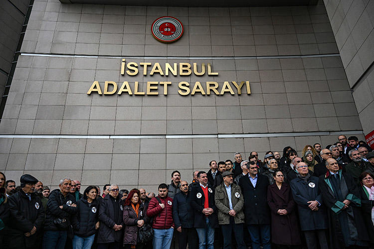 Lawyers and opposition MPs gather outside an Istanbul courthouse in February to protest an appeal court ruling on Cumhuriyet staff. Lawyers for the Cumhuriyet employees held a press conference about the case on April 22. (AFP/Ozan Kose)