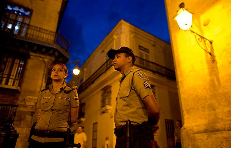 Police officers are seen in Havana, Cuba, on March 18, 2016. Journalist Augusto César San Martín was recently detained, fined, and had his equipment confiscated in Havana. (AP/Rebecca Blackwell)