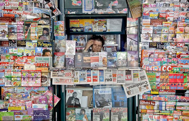 A newspaper vendor is seen in Bucharest, Romania, on May 30, 2017. Romanian reporter Emilia Șercan recently received death threats relating to her work. (AP/Vadim Ghirda)