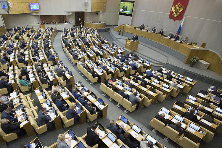 Russian lawmakers are seen in the State Duma on May 22, 2018. The Duma recently considered amendments that would restrict foreign print media in the country. (AP/Pavel Golovkin)