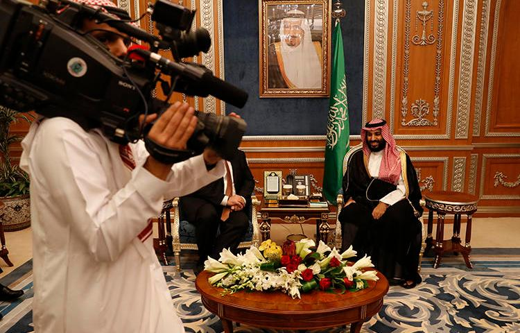 A cameraman gets into position as U.S. Secretary of State Mike Pompeo meets with Saudi Crown Prince Mohammed bin Salman in Riyadh, Saudi Arabia, on October 16, 2018. At least four journalists were recently arrested in Saudi Arabia, and their whereabouts are unknown. (AP/Leah Millis)