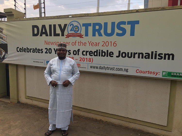 Nurudeen Abdallah, investigations editor of the Daily Trust, pictured outside the newspaper's headquarters in Abuja. The paper was raided by the military in January. (CPJ/Jonathan Rozen)