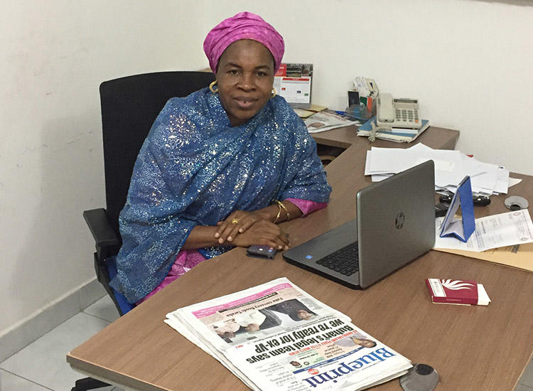 Zainab Suleiman Okino sits at her desk in the Blueprint office in Abuja. (CPJ/Jonathan Rozen)