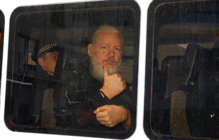 WikiLeaks founder Julian Assange is seen in a police van after he was arrested in London on April 11, 2019. (Reuters/Henry Nicholls)