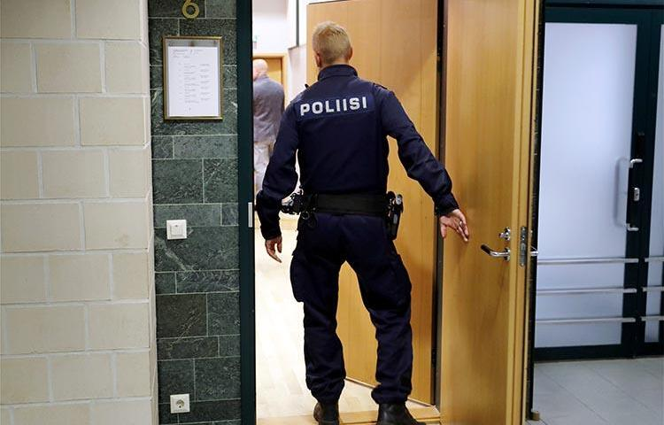 A police officer is seen in a court in Tampere, Finland, on July 5, 2016. A journalist in Oulou was recently convicted on criminal defamation charges. (Lehtikuva/Kalle Parkkinen/via Reuters)