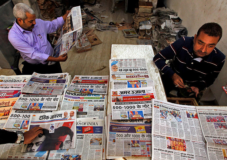 A man reads a newspaper in Allahabad, India, on November 9, 2016. A Bengaluru court recently passed a gag order barring the Indian press and international social media networks from publishing derogatory remarks about a local political candidate. (Reuters/Jitendra Prakash)