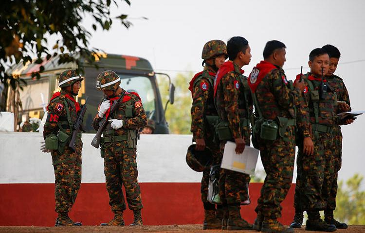 Soldiers are seen in the Ayeyarwaddy Delta region in Myanmar on February 2, 2018. The Myanmar military recently sued independent news outlet The Irrawaddy for defamation over its coverage. (Reuters/Lynn Bo Bo/Pool)