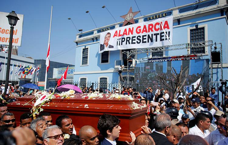 Friends and family carry the coffin of Peru's former president, Alan Garcia, who killed himself on April 17, in Lima, Peru, on April 19, 2019. Some government officials have blamed Peruvian investigative journalists for his suicide, and engaged in a harassment campaign. (Reuters/Janine Costa)