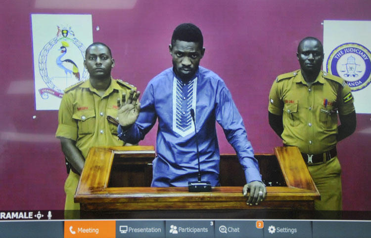 Ugandan pop star and opposition figure Bobi Wine appears for his bail application via a video link from prison, on a television screen in a court in Kampala, Uganda, on May 2, 2019. Uganda's media regulator suspended staff from 13 broadcast outlets for covering his arrest. (AP/Ronald Kabuubi)