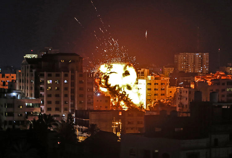 The explosion from an Israeli airstrike is seen in Gaza City on May 4, 2019. A building housing the Turkish Anadolu news agency's Gaza office was destroyed by Israeli forces that evening. (AFP/Mahmud Hams)