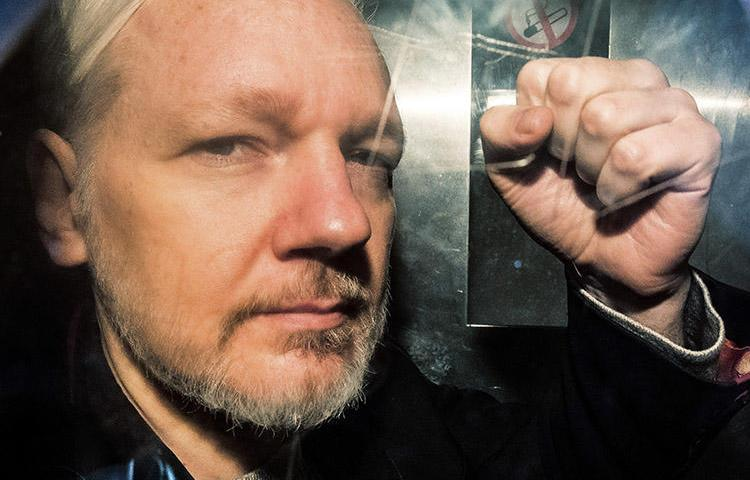WikiLeaks founder Julian Assange, pictured in a prison van in the U.K. on May 1, 2019. The U.S. has disclosed charges under the Espionage Act against Assange. (AFP/Daniel Leal-Olivas)