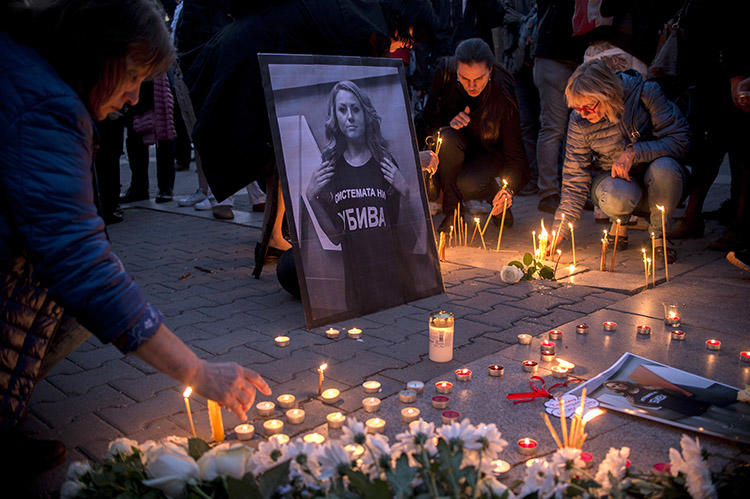 A vigil for TVN host Viktoria Marinova, in Sofia, in October 2018. Prosecutors ruled her murder was not related to her work, but the case highlighted the risks for Bulgaria's investigative journalists. (AFP/Nikolay Doychinov)