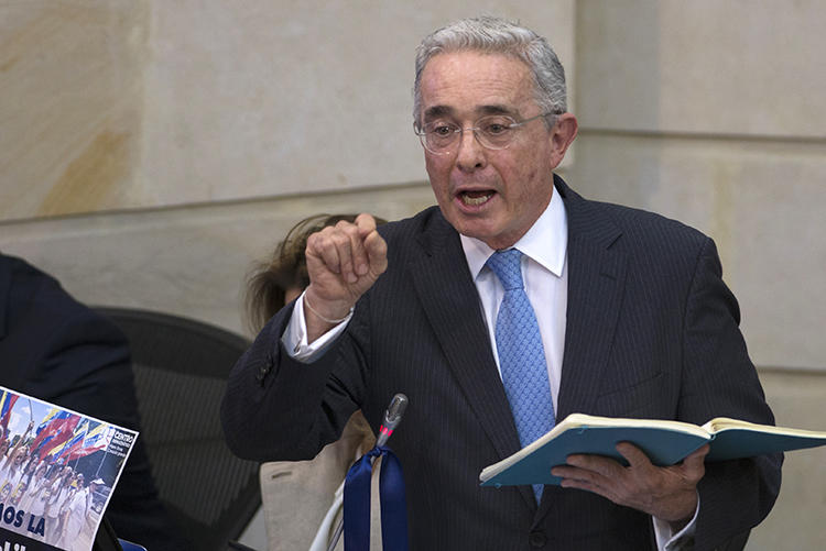 Senator Alvaro Uribe Velez is seen at the National Congress in Bogota, Colombia, on April 30, 2019. Uribe and his allies have recently filed defamation suits and retraction requests against journalist Daniel Coronell. (AFP/Diana Sanchez)