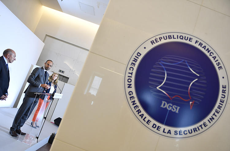 The logo of the General Directorate for Internal Security, France's domestic intelligence agency, is seen at its headquarters in Levallois-Perret on July 13, 2018. The agency has recently summoned reporters for questioning in a leak investigation. (AFP/Gerard Julien)