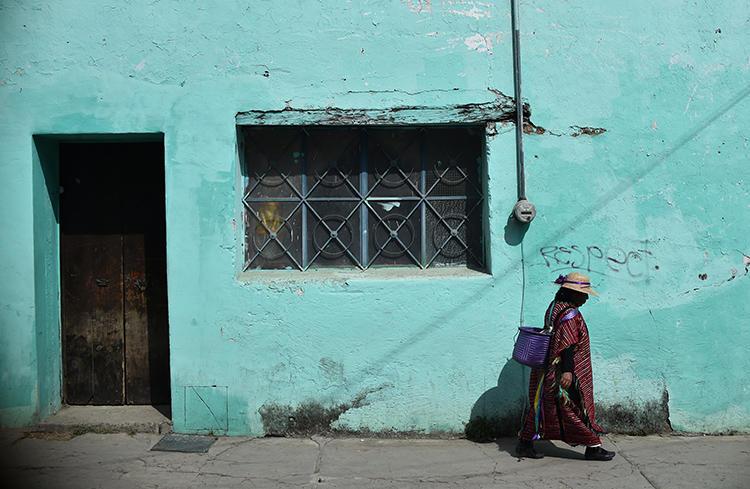 An indigenous woman walks in Tlaxiaco, Oaxaca state, on February 15, 2019. Telésforo Enríquez, the founder of a community radio station, was found shot dead in the town of San Agustín Loxicha, Oaxaca, on May 2. (AFP/Rodrigo Arangua)