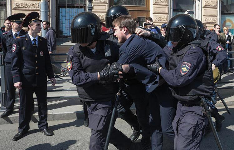 Police detain a protester during a May Day rally in Saint Petersburg, Russia, on May 1, 2019. Two journalists were also arrested at the protest, and one was allegedly assaulted by police. (AFP/Valentin Yegorshin)
