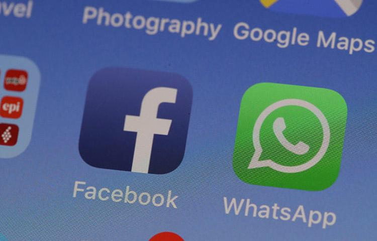 The WhatsApp messaging app is displayed on an iPhone in May 2019. WhatsApp is advising users to update the messaging app after a vulnerability was identified. (AFP/Justin Sullivan/Getty Images)
