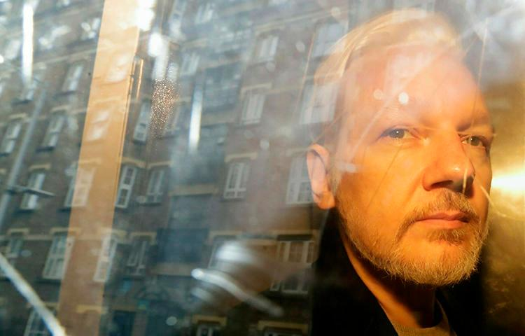 WikiLeaks founder Julian Assange is seen in London on May 1, 2019. Assange was recently indicted in the United States under the Espionage Act, the first such case conducted against a publisher. (AP/Matt Dunham)