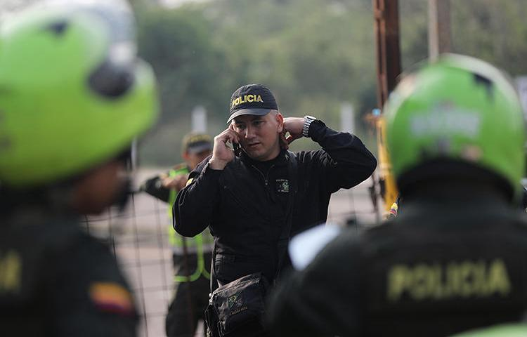A police officer is seen in Cucuta, Colombia, on February 7, 2019. Documentary filmmaker Mauricio Lezama was recently shot and killed in the village of La Esmeralda. (Reuters/Luisa Gonzalez)