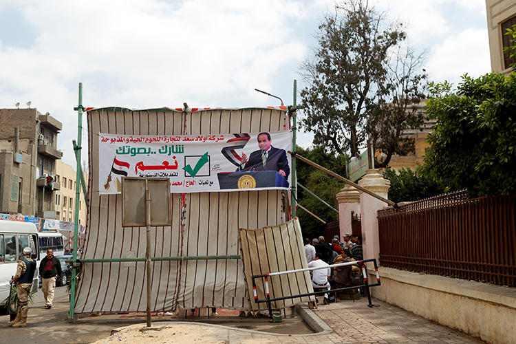 A banner depicting Egyptian President Abdel Fattah el-Sisi is seen outside a polling station, during the referendum on draft constitutional amendments, in Cairo, Egypt, on April 20, 2019. (Reuters/Amr Abdallah Dalsh)