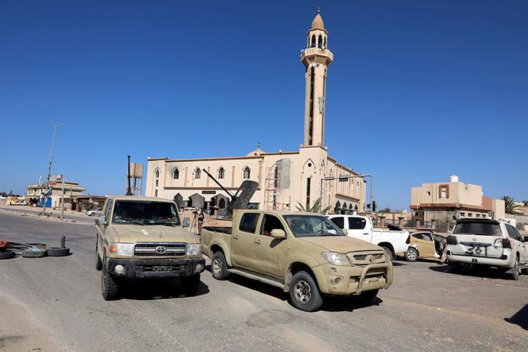 Military vehicles are seen in Salah al-Din, south of Tripoli, Libya, on May 7, 2019. Two Libyan journalists were recently abducted in Tripoli by forces affiliated with the Libyan National Army. (Reuters/Hani Amara)