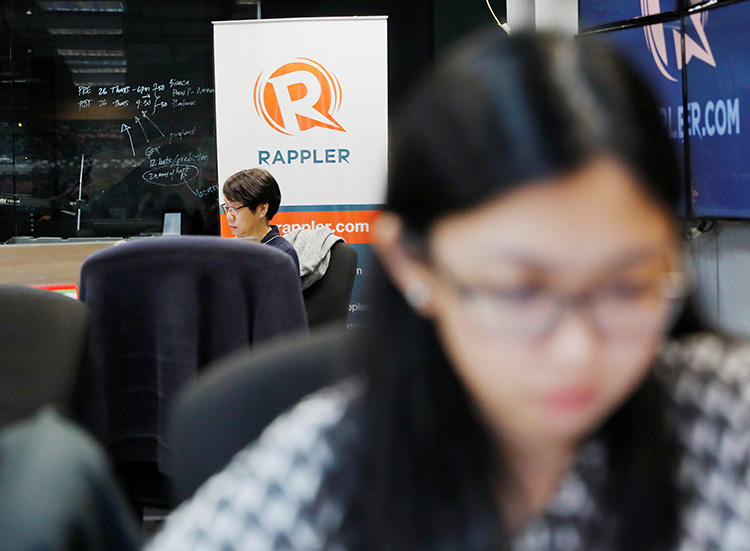 Journalists pictured in the Manila offices of Rappler, in January 2018. The outlet is one of four Philippine media groups smeared in a campaign that alleges they are in the pay of the CIA. (Reuters/Dondi Tawatao)