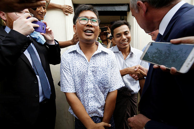 Reuters reporters Wa Lone and Kyaw Soe Oo, pictured as they are freed from prison in Yangon, Myanmar, on May 7 after receiving a presidential pardon. (Reuters/Ann Wang)
