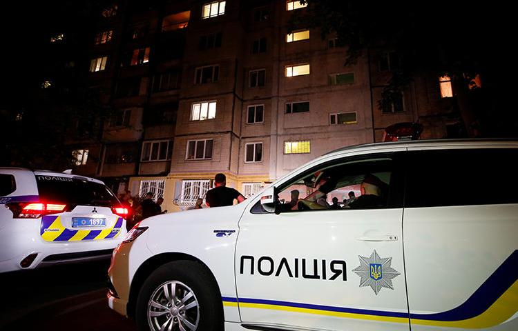 Police cars are seen in Kiev, Ukraine, on May 29, 2018. A journalist was recently attacked in Cherkasy and is now in a coma. (Reuters/Gleb Garanich)