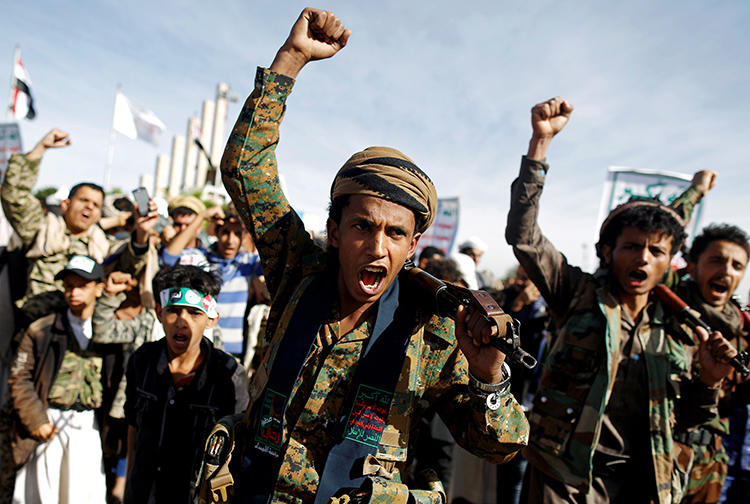 Supporters of the Houthi movement attend a rally to mark the fourth anniversary of the Saudi-led military intervention in Yemen's war, in Sanaa, Yemen, on March 26, 2019. The Houthis are currently detaining at least 10 journalists in harsh conditions. (Reuters/Khaled Abdullah)