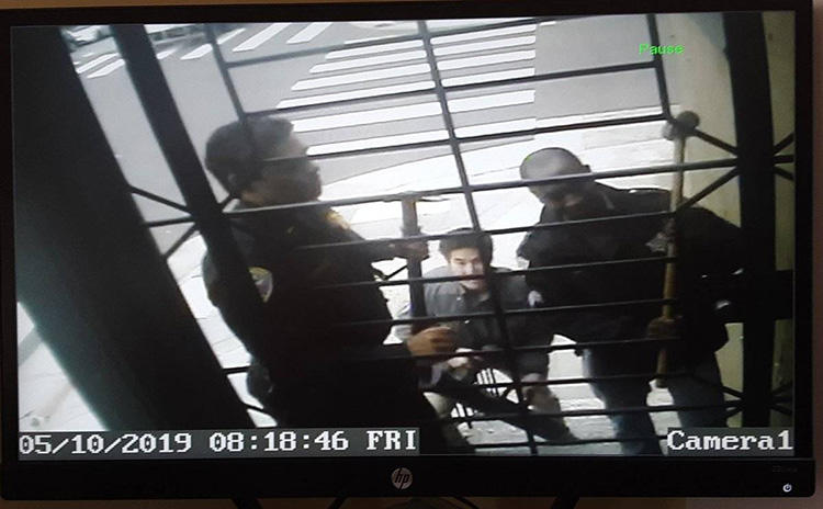 Security camera footage shows police during a raid on the home of freelancer Bryan Carmody, in San Francisco, on May 10. Officers confiscated electronic devices and documents. (Bryan Carmody)