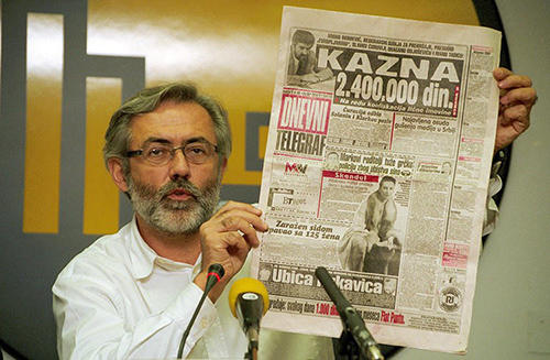 A November 1, 1998, photo of Serbian journalist Slavko Curuvija at a press conference in Belgrade. A Serbian court on April 5, 2019, sentenced four former intelligence officers to decades in prison for the 1999 killing of Curuvija. (AFP/Andrej Isakovic)