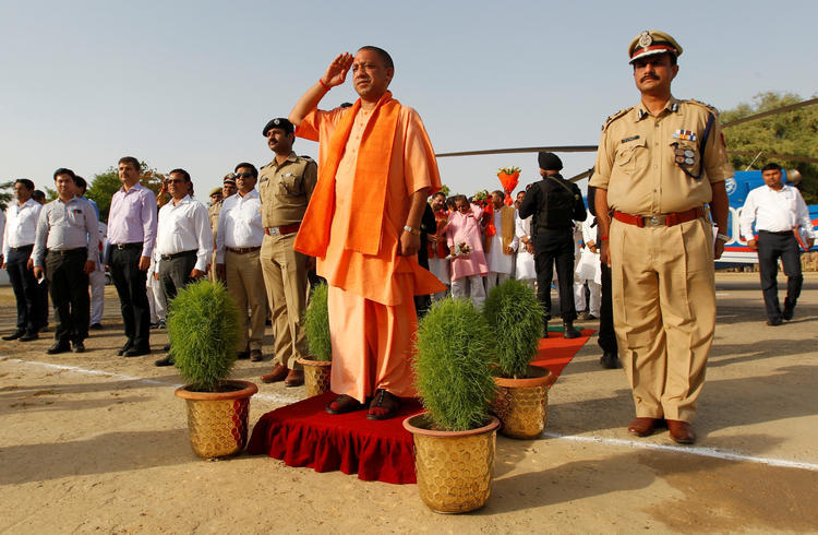 Yogi Adityanath, chief minister of India's most populous state, Uttar Pradesh, salutes as he inspects an honor guard during a visit to Allahabad, India, June 3, 2017. REUTERS/Jitendra Prakash