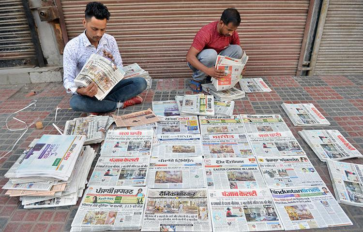 Newspaper distributors are seen in Amritsar, India, on April 22, 2019. The Indian government recently stopped placing advertisements in three major newspaper groups in apparent retaliation for their coverage. (AFP/Narinder Nanu)