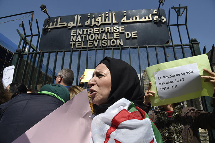 Algerian journalists take part in a demonstration outside the headquarters of the country's national television broadcaster in Algiers on March 25, 2019. At least two journalists were recently suspended from the broadcaster. (AFP/Ryad Kramdi)