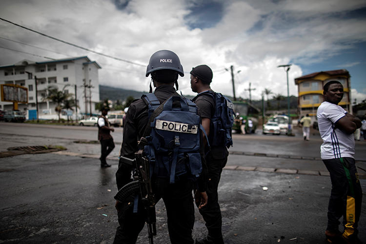 Cameroonian police officers are seen on October 3, 2018. Police recently arrested journalist Paul Chouta on criminal defamation and false news charges. (AFP/Marco Longari)