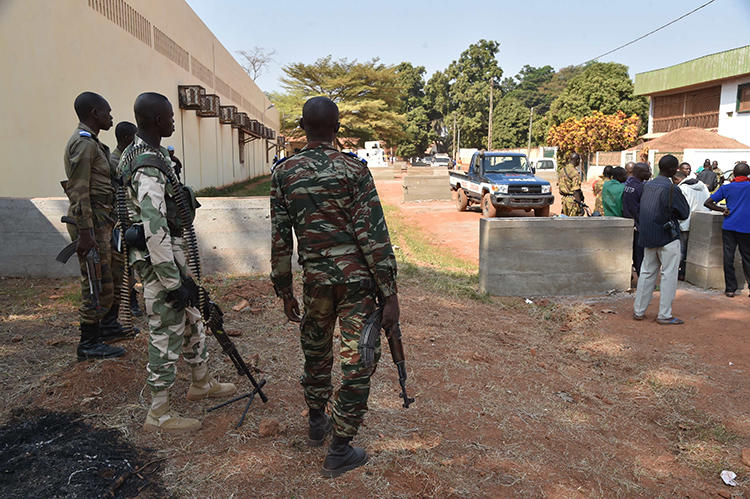 Central African Republic gendarmes and police officers are seen on January 2, 2016, in Bangui. Police in Bangui allegedly assaulted two French reporters from AFP recently. (AFP/Issouf Sanogo)
