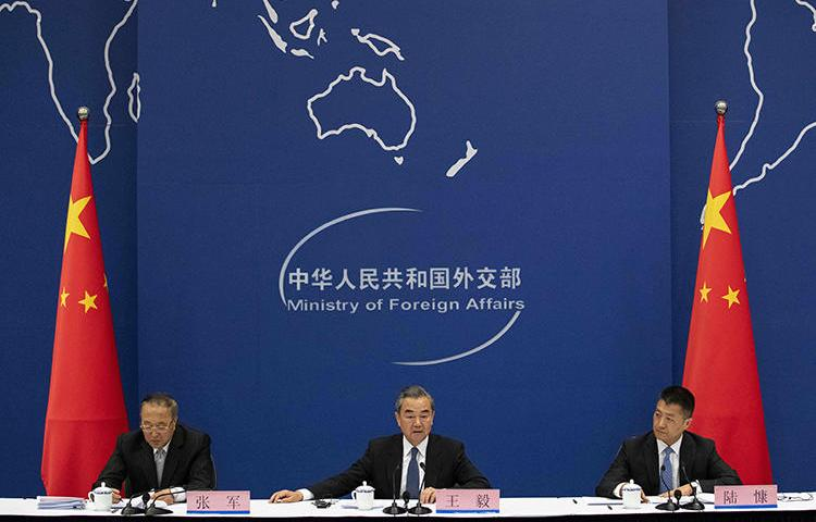 China's Foreign Minister Wang Yi (center) is seen in Beijing on April 19, 2019. China's Ministry of Foreign Affairs recently denied a visa to reporter Bethany Allen-Ebrahimian. (AFP/Nicolas Asfouri)