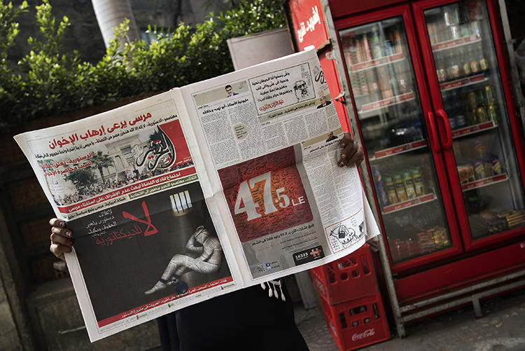 A copy of Egyptian newspaper al-Tahrir is seen in Cairo on December 3, 2012. The newspaper is facing insolvency after its website was blocked in May. (AFP/Gianluigi Guercia)
