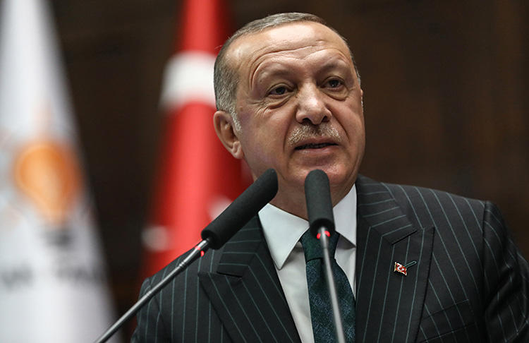 President Recep Tayyip Erdoğan speaks during a parliamentary group meeting at the Grand National Assembly of Turkey in Ankara on June 25, 2019. Two journalists are to stand trial, in separate cases, on charges of insulting the president. (AFP/Adem Altan)