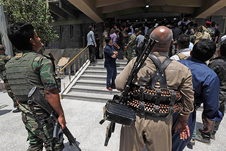 Kurdish security forces are seen in Erbil, Iraqi Kurdistan, on July 23, 2018. Security forces recently harassed and attempted to arrest journalist Barzan Ali Hama. (AFP/Safin Hamed)