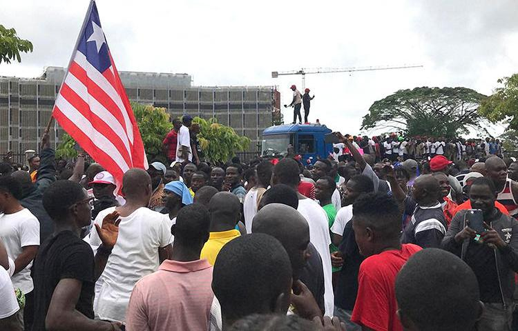 Demonstrators are seen in Monrovia, Liberia, on June 7, 2019. Amid the protests, social media services were disrupted throughout Liberia. (AFP/Carielle Doe)