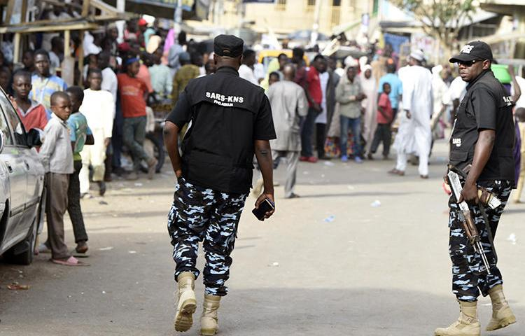 Federal Special Anti-Robbery Squad officers are seen in Kano, Nigeria, on February 23, 2019. Journalist Kofi Bartels told CPJ he was recently assaulted and threatened by anti-robbery officers. (AFP/Pius Utomi Ekpei)