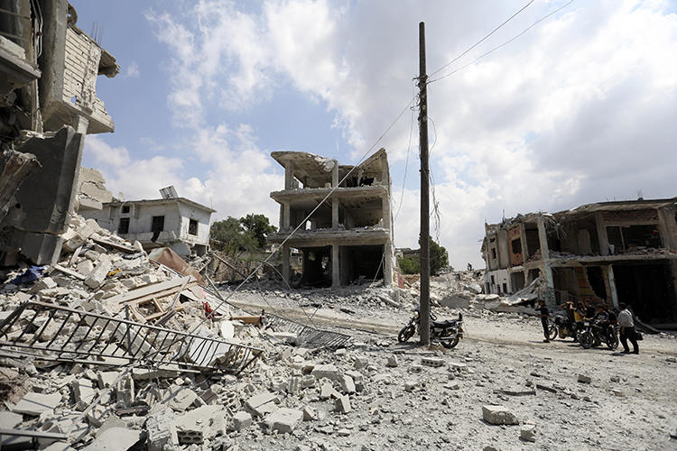 A damaged building is seen in Idlib, Syria, on June 14, 2019. Photojournalist Amjad Hassan Bakir was recently killed in an airstrike in Idlib. (AFP/Omar Haj Kadour)