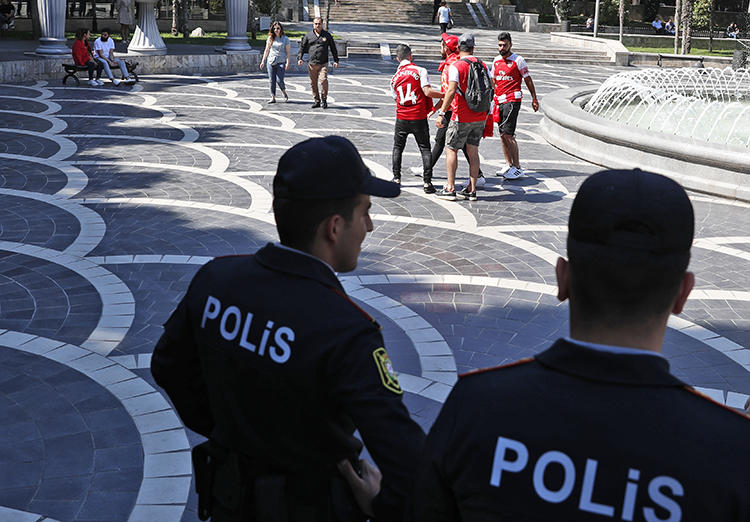 Police officers are seen in Baku, Azerbaijan, on May 29, 2019. Azerbaijani authorities recently jailed two journalists in unrelated cases. (AP/Darko Bandic)