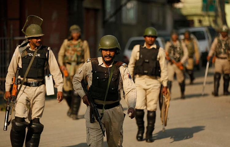 Police are seen in Srinagar, Indian-controlled Jammu and Kashmir, on May 21, 2019. Police in Jammu and Kashmir recently arrested journalist Ghulam Jeelani Qadri. (AP/Mukhtar Khan)