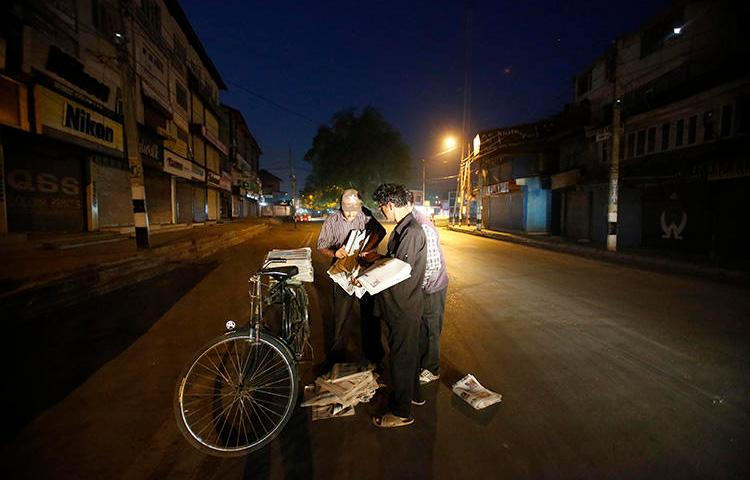 Newspaper vendors collect copies of the papers in Srinagar, in July 2016. The Kashmir Times, one of the oldest papers in Indian-controlled Jammu and Kashmir, is suffering under a nearly 10-year ban on government advertising. (AP/Mukhtar Khan)