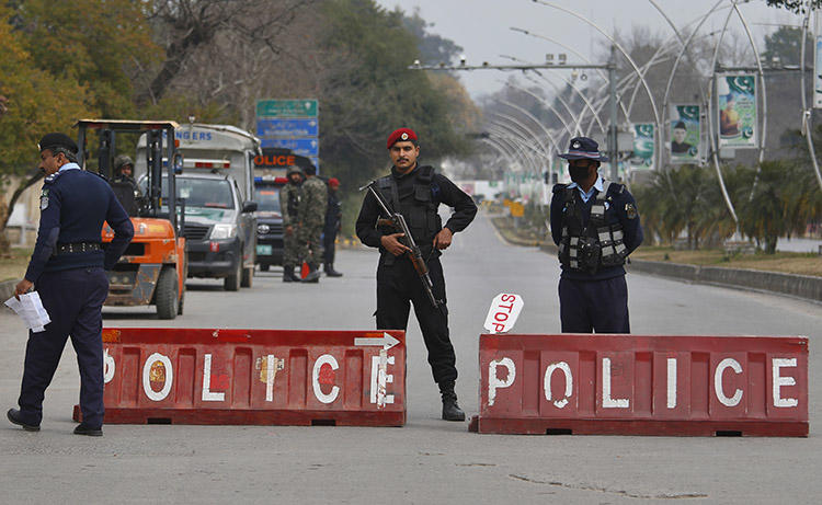 Pakistani police officers are seen in Islamabad on February 17, 2019. Journalist Muhammad Bilal Khan was recently stabbed to death in Islamabad. (AP/Anjum Naveed)