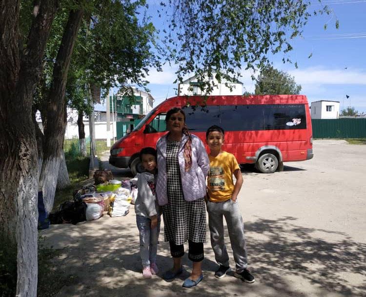 Khadicha Askarova, pictured with her grandchildren in May 2019, as the family travels over 600km to see Azimjon Askarov in prison on his birthday. (Askarov family)