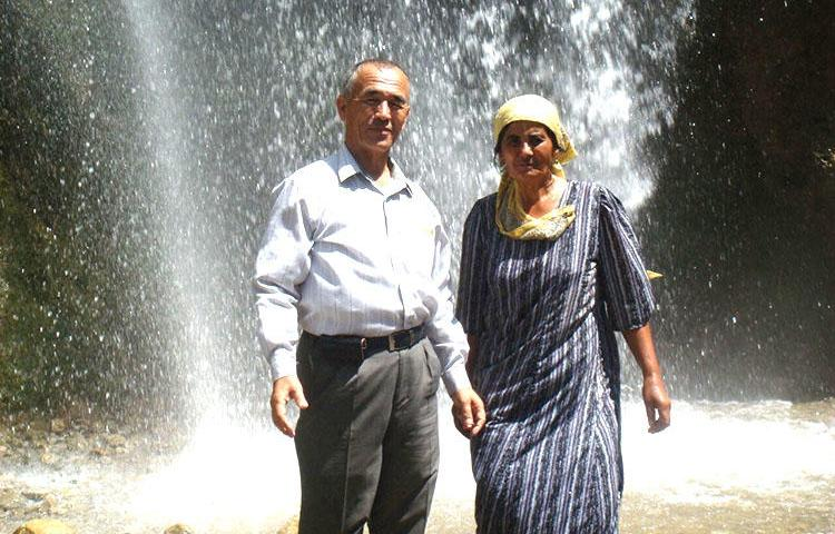 Kyrgyzstan journalist Azimjon Askarov and his wife, Khadicha, pictured during a family vacation in Arslanbob in the summer of 2009. 'This was Azimjon's last summer of freedom,' Khadicha told CPJ. (Askarov family)